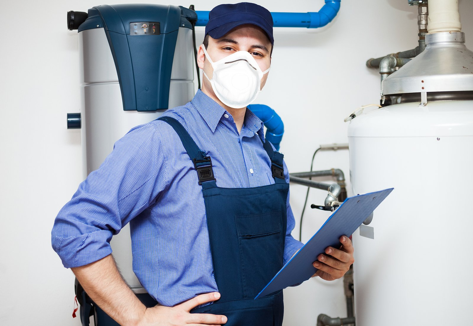Smiling-Technician-Wearing-Mask-Servicing-a-Hot-Water-Heater